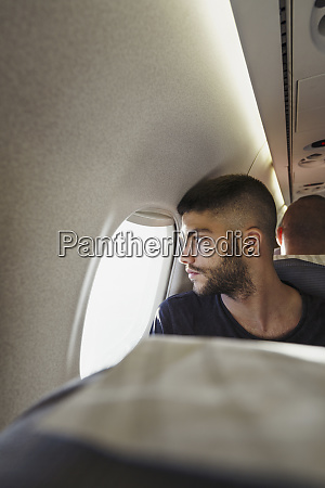 young man in a plane looking