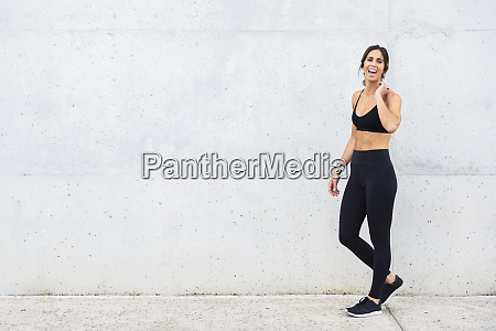 laughing athlete standing in front of
