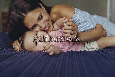 happy mother cuddling with her baby