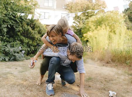 happy carefree family in garden