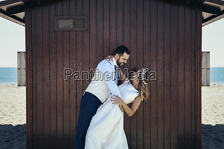 bridal couple enjoying romantic moments in