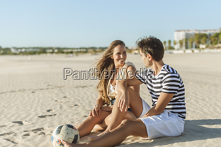 smiling young couple sitting on the