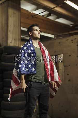 man wearing american flag holding a