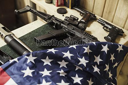 rifles guns and american flag on
