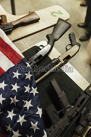 rifles and american flag on table