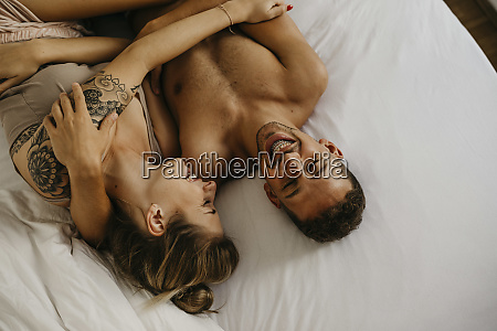 romantic happy young couple lying in