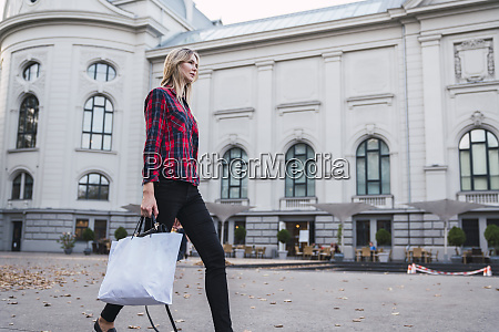 fashionable young woman with shopping bag