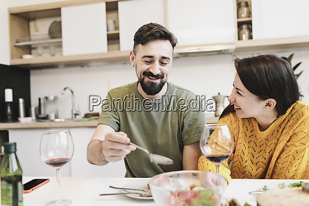 happy couple in love having lunch