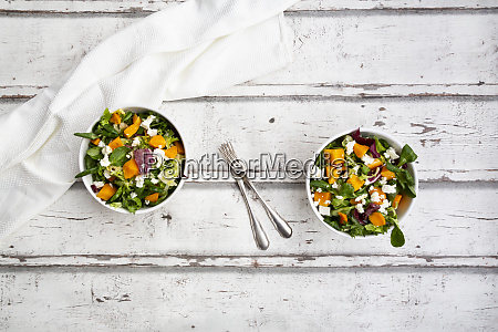 bowls of autumnal salad with feta
