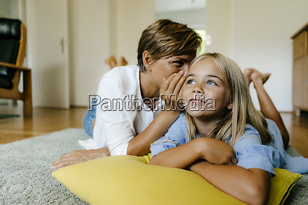 mother and daughter lying on the