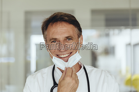 portrait of a doctor removing surgical