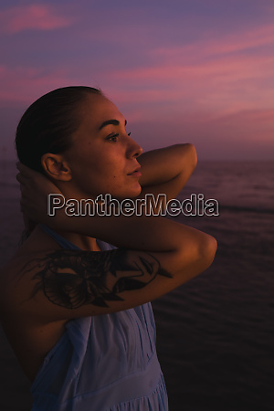 profile of young woman with tattoo