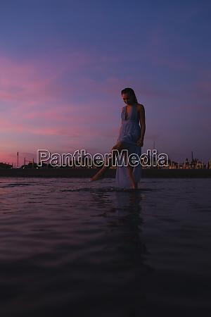 young woman wearing summer dress standing