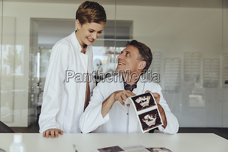 two doctors discussing ultrasound scan of