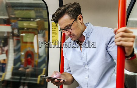 uk london businessman in underground train