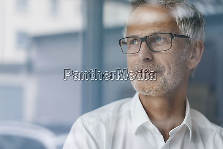 successful manager looking out of window