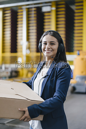 young woman working at parcel service