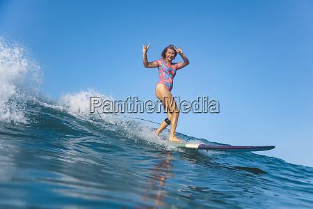 indonesia bali batubolong beach pregnant woman