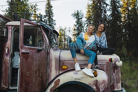 two friends sitting on a broken