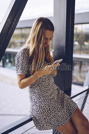 attractive young woman in leopard print