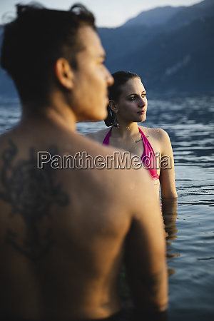 young couple in a lake at