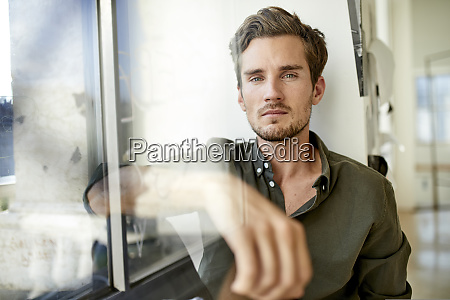 portrait of serious young man sitting
