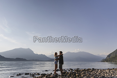 happy affectionate young couple embracing at
