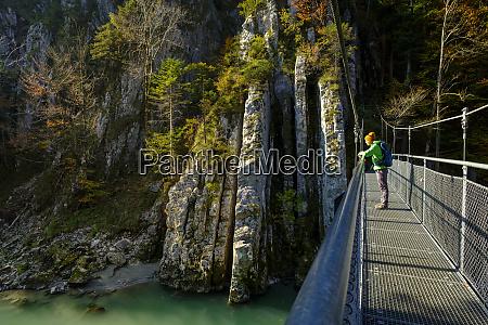 austria tyrol hiker on suspension bridge