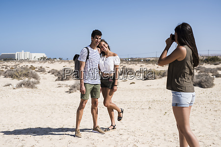 young woman taking pictures of a