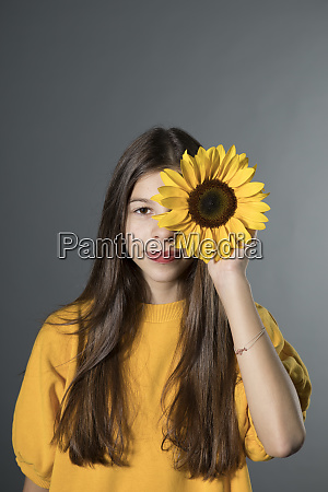 portrait of smiling girl with sunflower