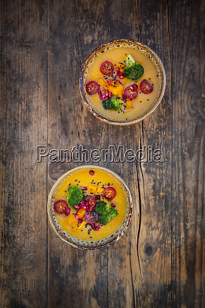 two bowls of curry dish with