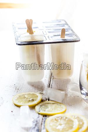 homemade gin lemon ice lollies in