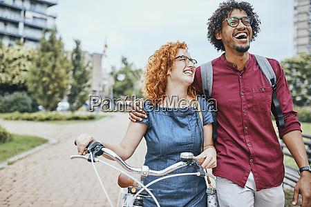 friends walking in park talking woman