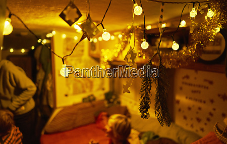 fairy lights in camper with family