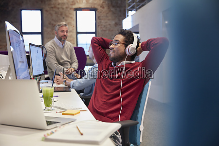 young man sitting at desk in