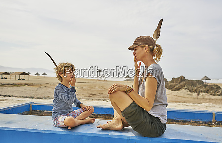 chile arica mother sitting with son