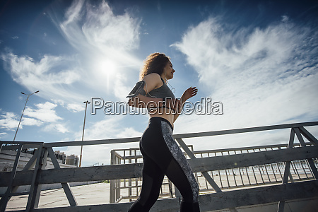 young athletic woman running on a