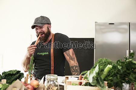 vegan man heating carrot in his