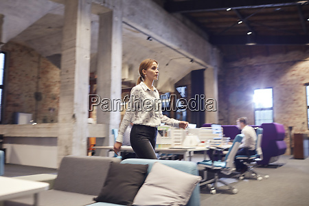 busy woman walking in modern office
