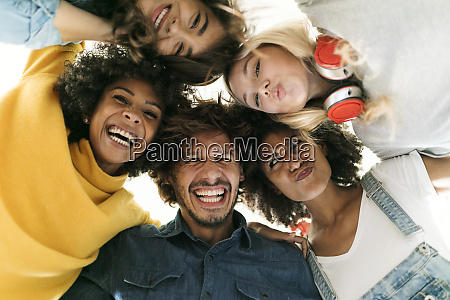 group portrait of cheerful friends huddling