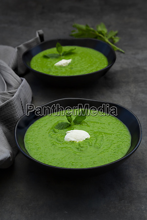 two bowls of pea mint soup