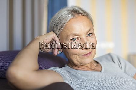 portrait of smiling senior woman relaxing