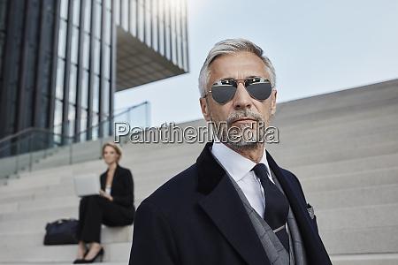 portrait of mature businessman wearing mirrored