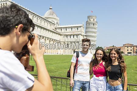 italy pisa group of friends posing