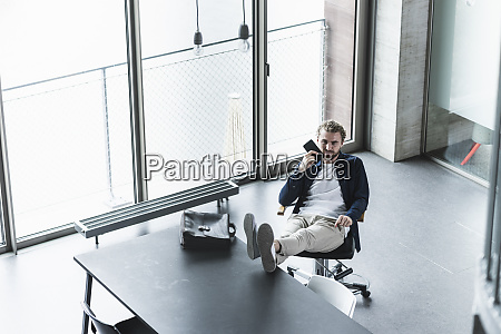 casual businessman sitting in office with
