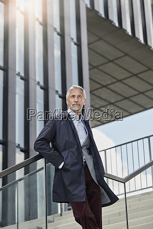 portrait of mature businessman standing on