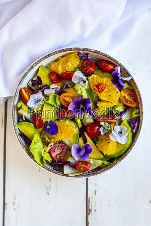bowl of mixed salad with avocado