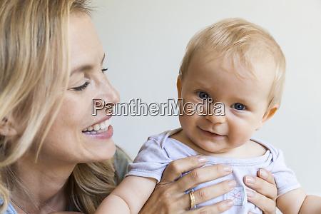 portrait of happy baby girl held