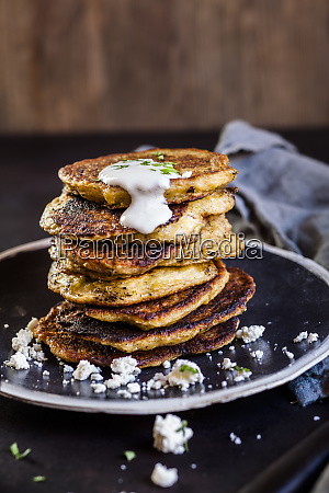 stack of zucchini fritters with garlic