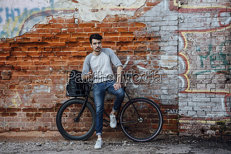 young man with commuter fixie bike